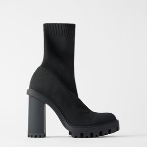 SOCK STYLE HEELED ANKLE BOOTS WITH LUG SOLES